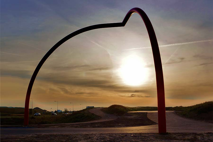 Sunrise under Gaia (or Gaea) - a red steel sculpture installed in Rhoon, NL.