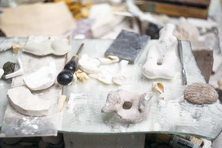 Henry Moore's work table with flint stones and plaster models - Hoglands in Perry Green studio in Much Hadham, England.