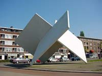 "Site specific concrete art is represented by ""perpendicular planes, homage to Oud and van Doesburg"", a concrete sculpture in Rotterdam."