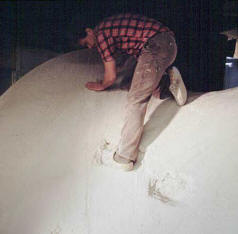 Working in his studio, the sculptor Lucien den Arend is constructing his plaster model for his bronze sculpture which he later titled 'Brenda'.