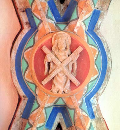 In the cross vault of the chapel of the fish merchants is a rosette depicting saint Andrew, their patron, holding a cross, which is the projection of my cross for the tower as seen from above.